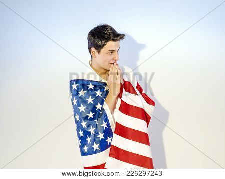 A Man Wrapped In An American Flag Praying