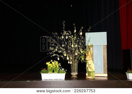 Lectern With Flower Decoration And Easter Bunny