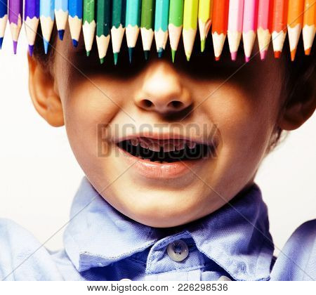 Little Cute Boy With Color Pencils Close Up Smiling, Education Face Colored Concept