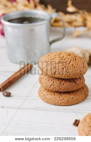 Ginger Snaps On White Wooden Surface With Spices Around.