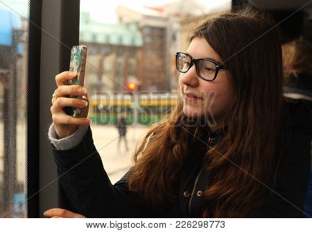 Teenager Girl In The Bus In Sight Correction Glasses Close Up Photo