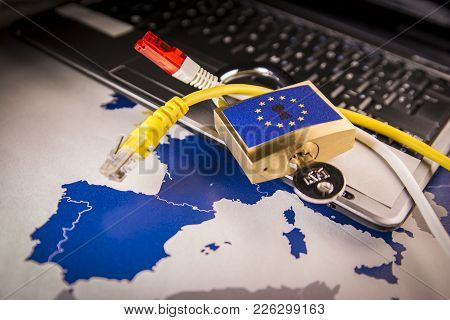 Padlock And Net Cable Over A Laptop And A Eu Map, Symbolizing The Eu General Data Protection Regulat