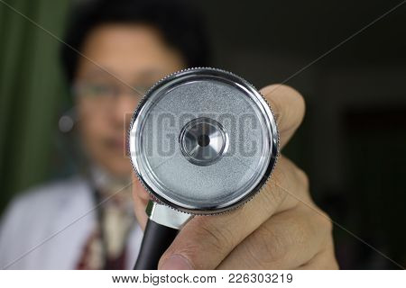 Metal Silver Stethoscope In Doctor Hand