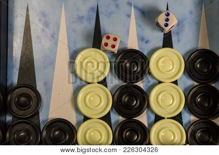 Game Field In A Backgammon With Dice And Checkers