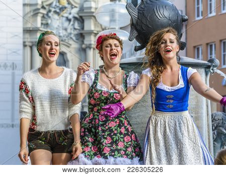 Street Performers, Dressed In Bavarian Traditional Costumes, Sing In Marienplatz On June 29, 2015 In