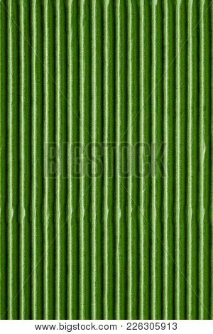 Wavy Corrugated Texture Of A Cardboard Or Paper Of Green Color For A Background Or For Wallpaper