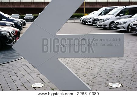 Stuttgart, Germany - February 03: A Directional Arrow To The Daimler Headquarters Of The Mercedes-be