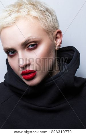 Portrait Of A Young Blond Woman With Short Hair And Lush Lips