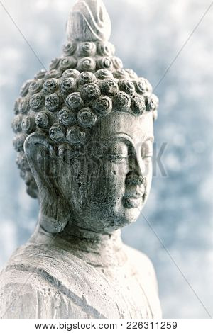 Buddha Statue on blue background