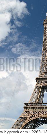 Eiffel Tower, Paris, Against A Blue Sky.
