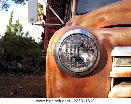 Rusty Vintage Truck Front Grill And Headlight.