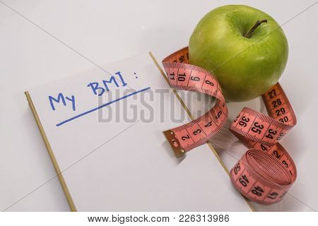 Bmi Body Mass Index Formula Rate Formula In A Notepad.bmi. Measuring Tape, A Marker And A Notepad Wi