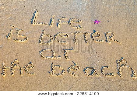 Life Is Better On The Beach Written In The Sand.