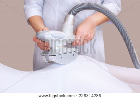 The Masseur Is Preparing To Make An  Hardware Massage In A Beauty Salon.