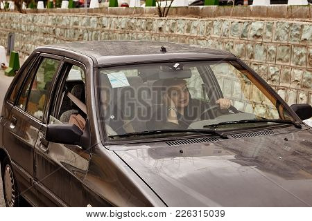 Tehran, Iran - April 28, 2017: Iranian Women In Hijabs Are Driving A Car, One Of Them Is Driving Thi