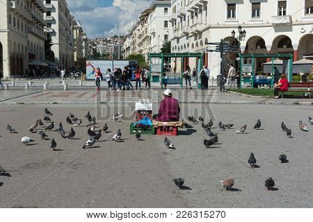 Thessaloniki, Greece - May 29, 2017: Famous Aristotelous Square In Thessaloniki, Greece. Woman Selli