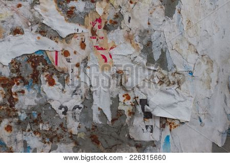 Old Street Billboard With Torn Peeled Poster Horizontal Background. Outdoor Bulletin Board Or Plywoo