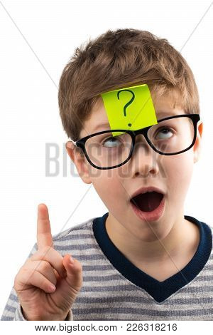 Confused Boy Thinking With Question Mark On Sticky Note On Forehead.