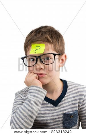 Confused boy thinking with question mark on sticky note on forehead. poster