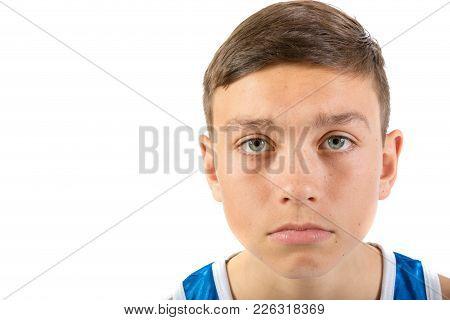Teenage Boy Headshot Looking Sad Agaisnt A White Background