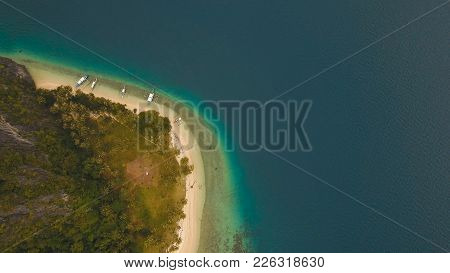 Beautiful Beach With Boats And Tourists. Tropical Bay In El Nido. Aerial View: Bay And The Tropical