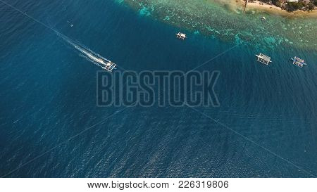 Aerial View Of Motor Boat In Sea, Moalboal. Aerial Image Of Motorboat Floating In A Turquoise Blue S