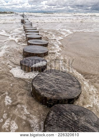 Old and weathered wooden wave breakers, Ustka, Baltic Sea, Poland