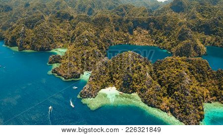 Aerial View: Lagoon With Blue, Azure Water In The Middle Of Small Islands And Rocks. Beach, Tropical