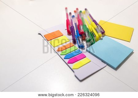 Adhesive Notes And Pencil Isolated On White Background With Clipping Path. Above View. Pen On Colorf