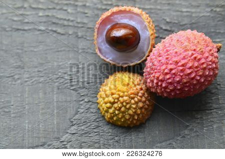 Fresh Organic Lychee Fruits And On A Rustic Wooden Background.exotic Tropical Litchi Berry.lychees.r