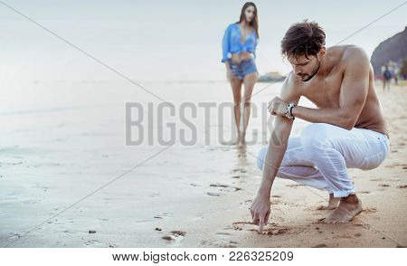 Happy young couple having fun on a beach