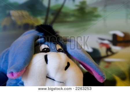 Stuffed animal roaming in a village along a busy river shallow DOF. poster