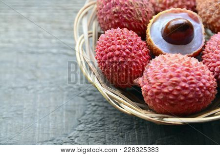 Fresh Organic Lychees In A Basket On Old Wooden Background.exotic Tropical Lychee Fruits.raw Diet Or