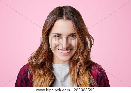 Cheerful Pleasant Looking Female Model Has Shining Smile With Perfect White Even Teeth, Glad To Reci