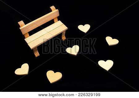 A Wooden Bench And Hearts. A Place For Visiting Lovers. Empty Bench. Frustrated Date. Disappointment