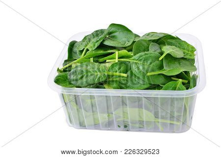 Baby Spinach Leaves In Plastic Container Isolated On White Background