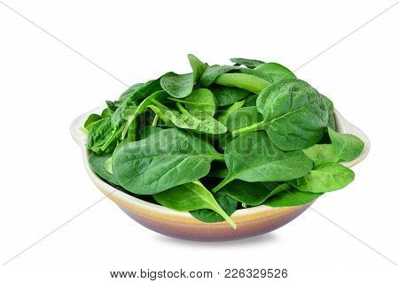 Baby Spinach Leaves In Stoneware Bowl Isolated On White Background
