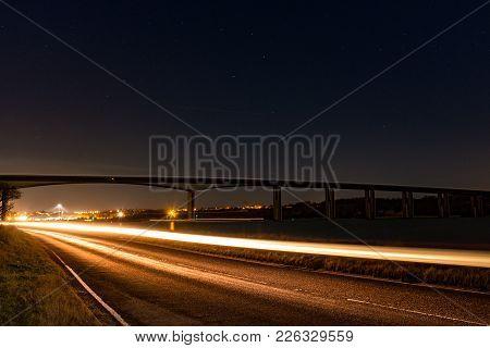Long Exposure Landscape Shot Of Orwell Bridge In Suffolk England