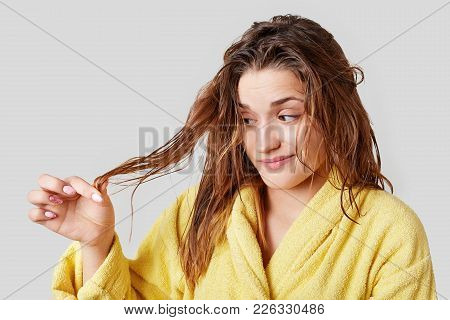 Adorable Female Looks At Split Ends After Taking Shower, Has Damaged Hair, Wears Domestic Clothes, I
