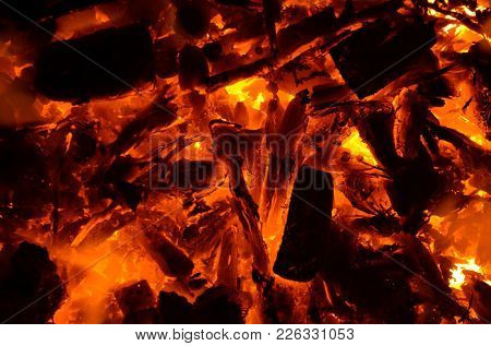 Burning Of Wood Lying On Top Of A Burning Coal Anthracite.