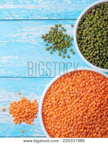 Red Lentils And Green Bean Or Mung Bean In Bowl On A Blue Wooden Table.copy Space.top View