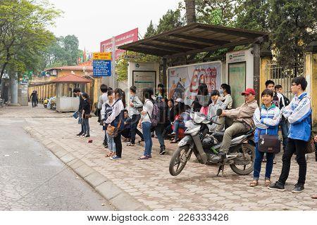 Hanoi, Vietnam - Mar 15, 2015: People Waiting For Bus At Bus Stop On Chua Boc Street, Hanoi