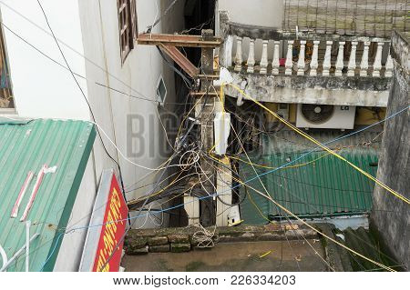 Hanoi, Vietnam - Mar 15, 2015: Electric Wires Cross Houses In Hanoi, Vietnam. Large Collections Of E