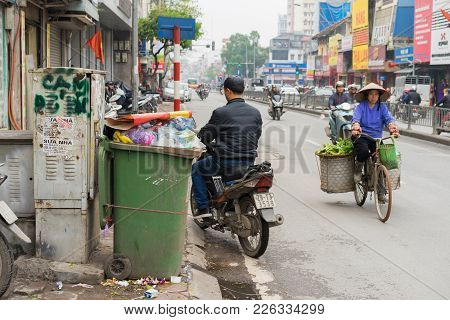 Hanoi, Vietnam - Mar 15, 2015: Wide View Of Hanoi Street Focusing On Rubbish Bin. The Word