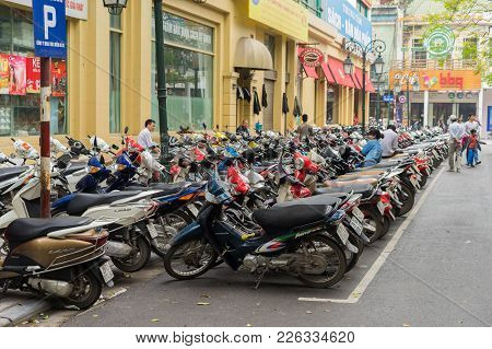 Hanoi, Vietnam - Mar 15, 2015: The Parking Of Motorbikes On Street In Trang Tien Street. Hanoi Lacks