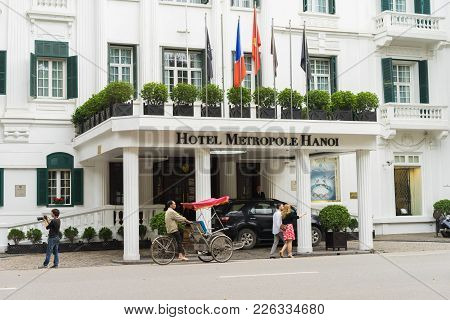 Hanoi, Vietnam - Mar 15, 2015: External Front View Of Hotel Sofitel Legend Metropole Hanoi With Runn