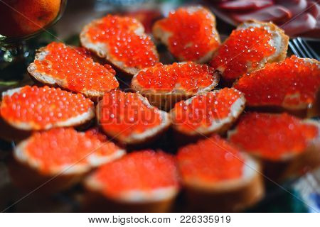 Sandwiches With Red Caviar Salmon With Oils. Traditional Russian Delicacy
