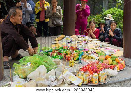 Quang Ninh, Vietnam - Mar 22, 2015: Vietnamese Buddhist Offerings In Cai Bau Temple . Visiting Pagod