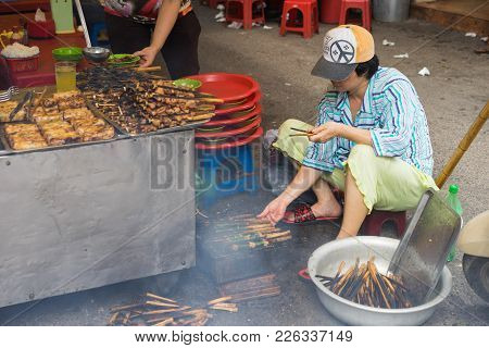 Hanoi, Vietnam - Apr 5, 2015: A Woman Broil Barbecue Meat - The Ingredient Of Bun Cha Is The Famous