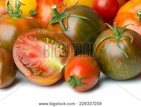 Heap Of Various Tomatoes Isolated On White Backgound